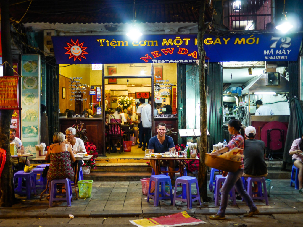eating on stools in vietnam